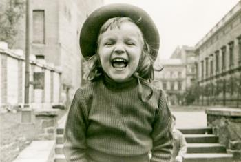 Vintage photograph of girl laughing
