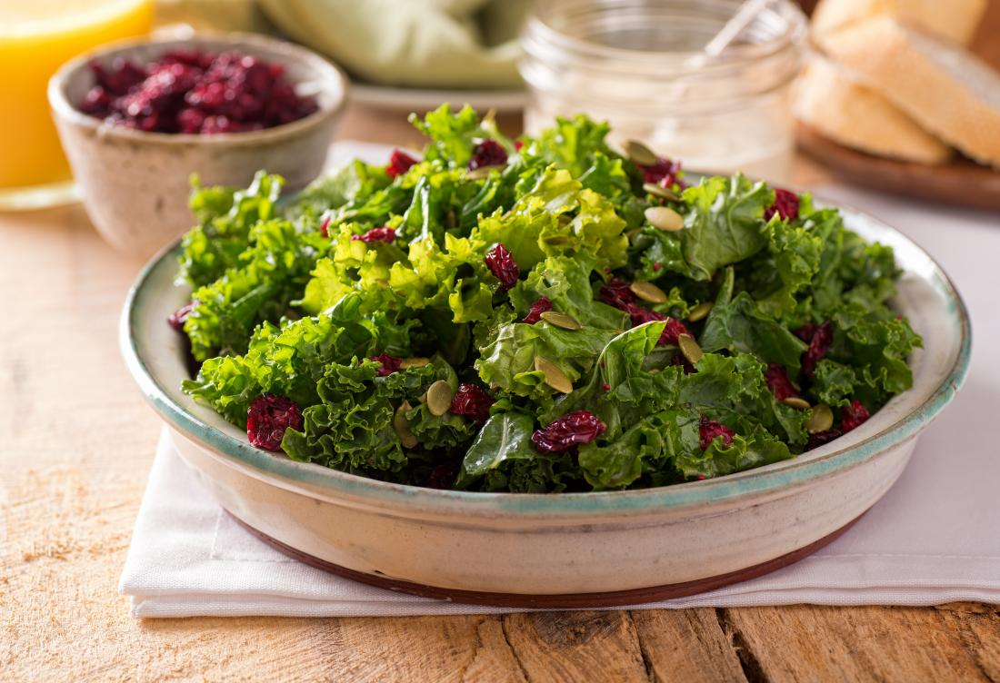 a kale salad with cranberries