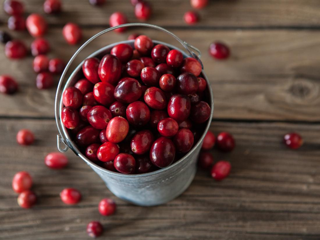 cranberries in a bucket.