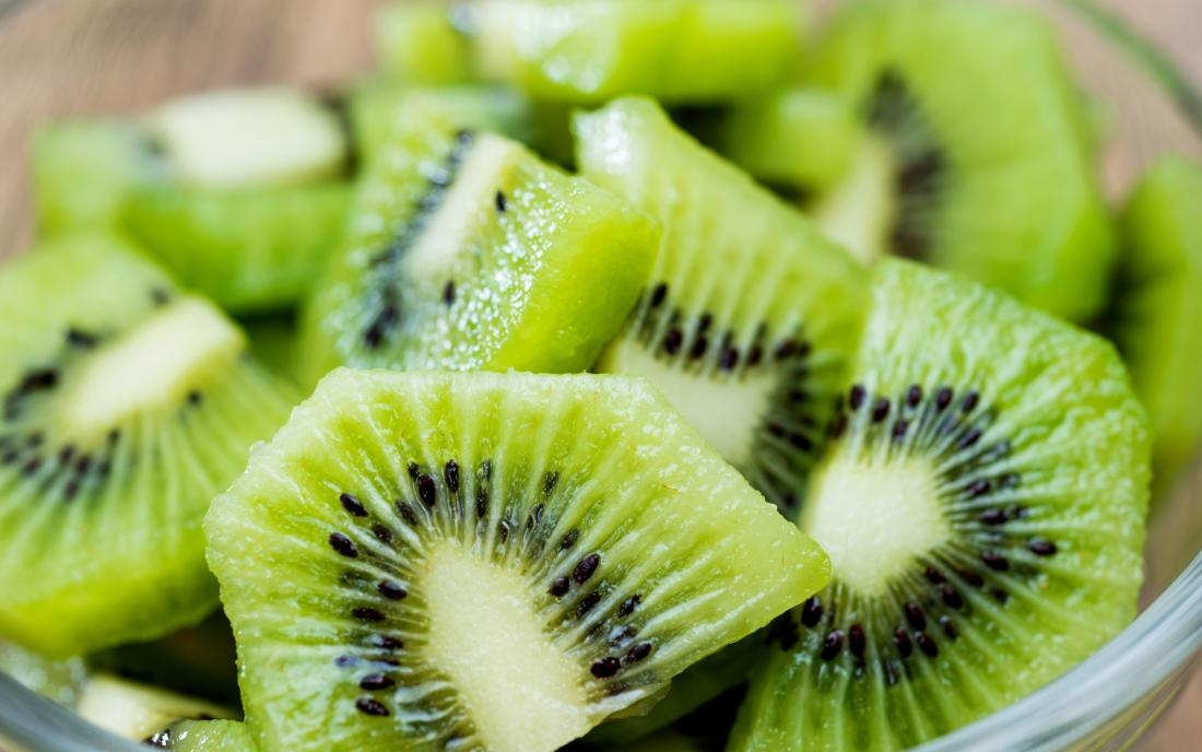 chopped kiwi in a bowl on a table