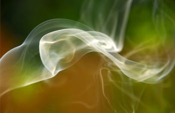 Swirling smoke on a multicolored background