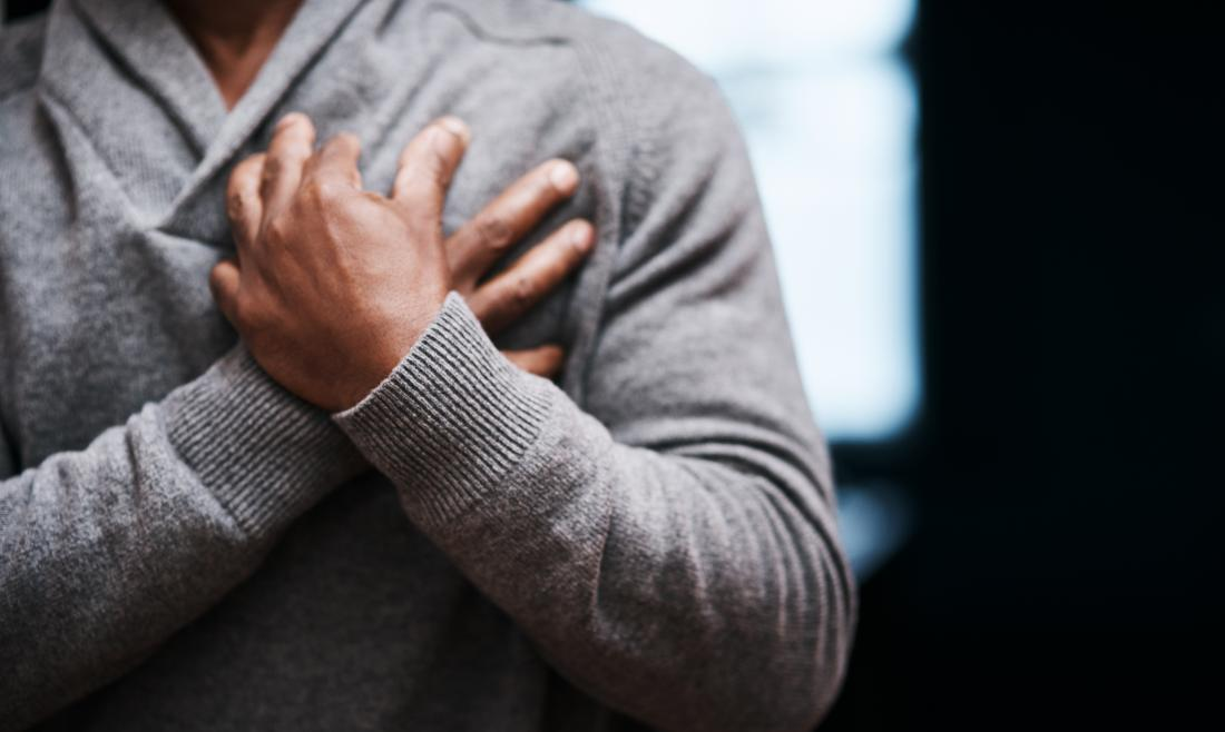 Man clutches chest struggling to breathe