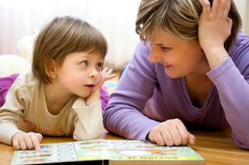 Preschooler reading with her mother