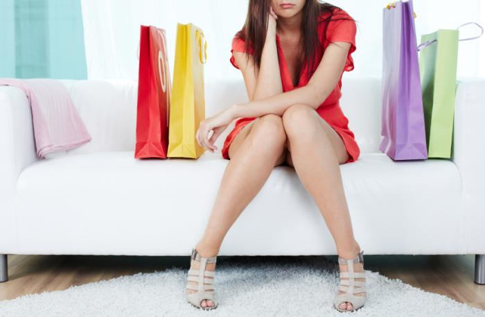 Unhappy woman with shopping bags