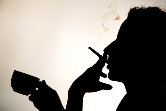 silhouette of person smoking