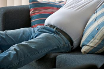 Overweight man on sofa