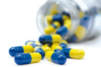 blue and yellow drug capsules