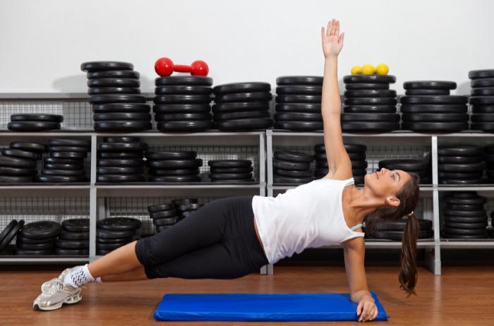 Woman performing the Side Plank yoga pose