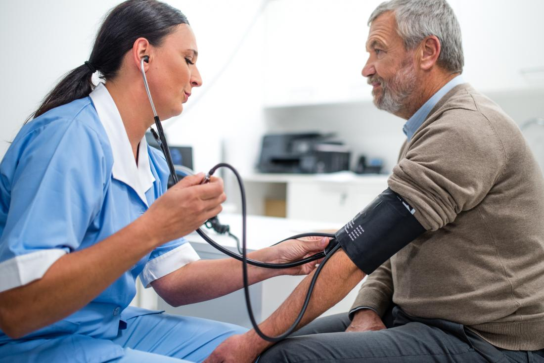 man has blood pressure taken