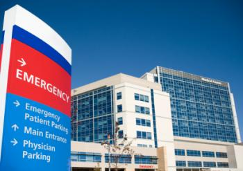 Sign pointing to hospital emergency department.