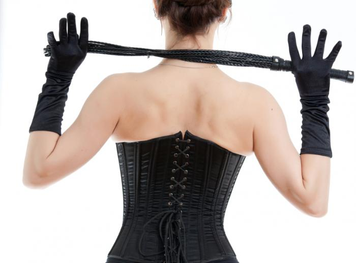 woman with corset and whip