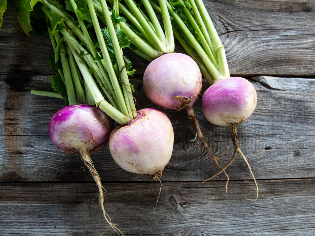 a bunch of turnips on a table.