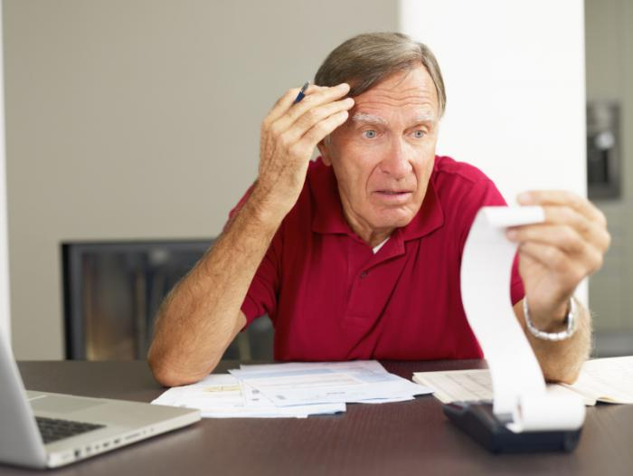 Older man worrying about finances