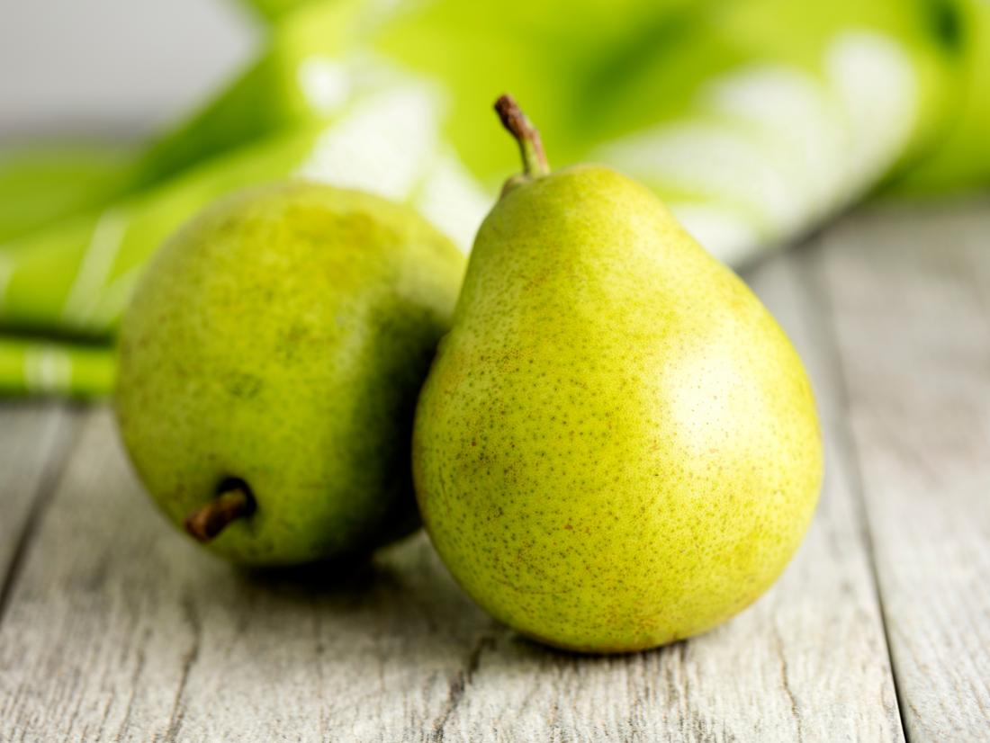 two pears on a table.