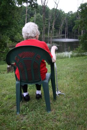 old lady sitting with walking stick