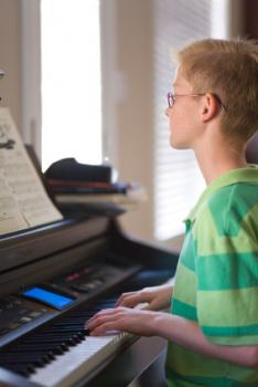 Boy playing keyboard.