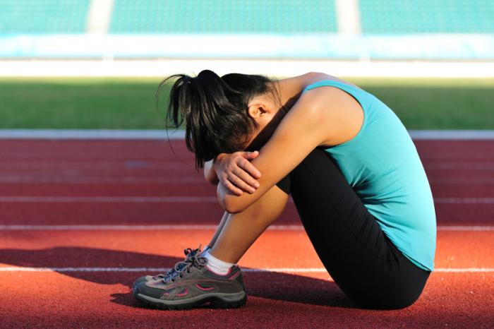 tired woman on running track