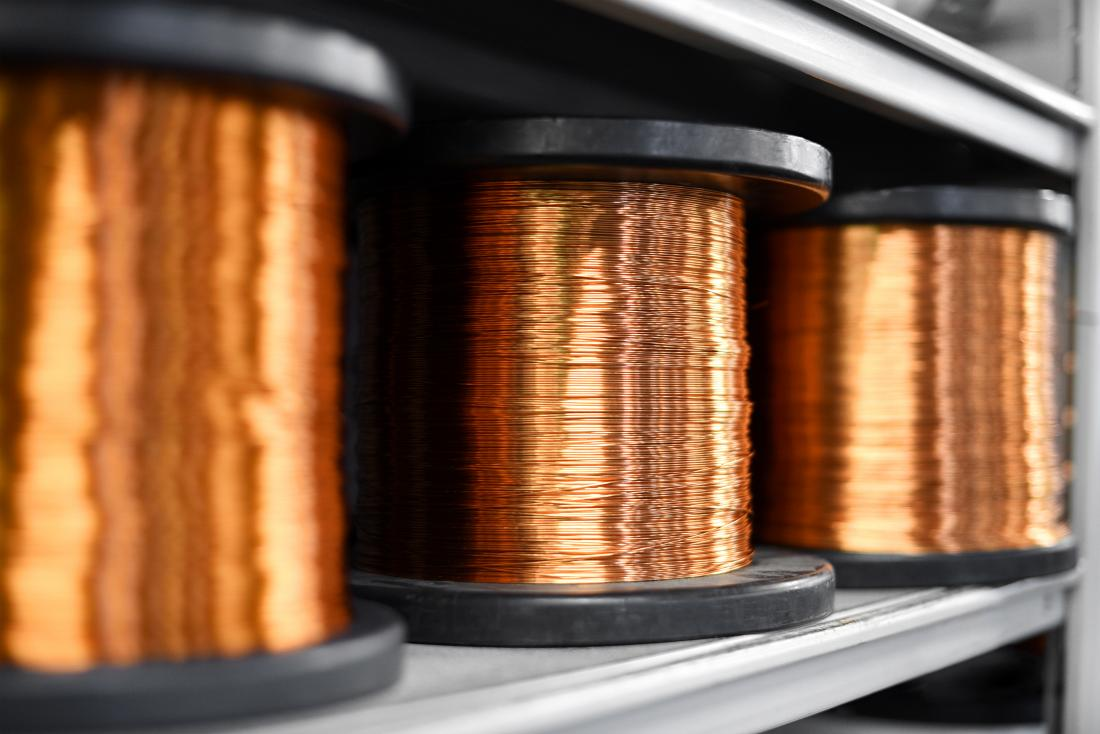 Copper wire spools on shelf