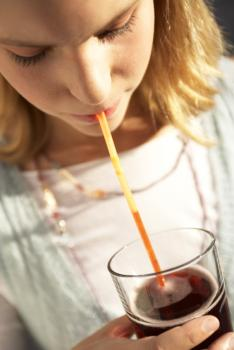 A girl drinking soda