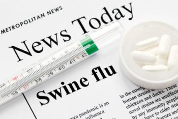 Newspaper article about swine flu, with thermometer and tablets.