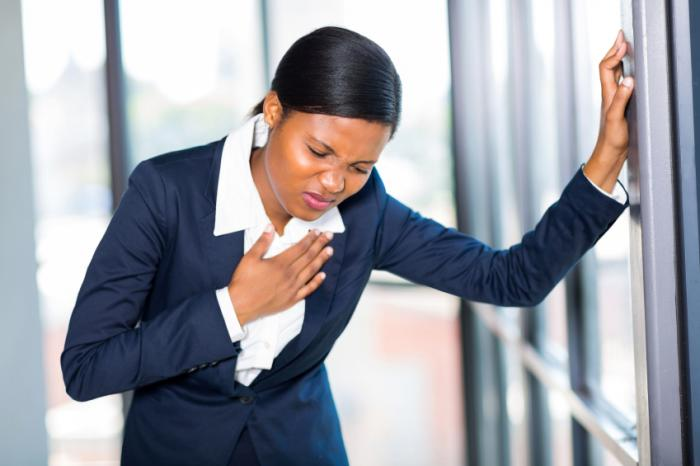 A woman experiencing chest pain
