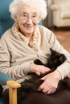 Older lady with pet cat