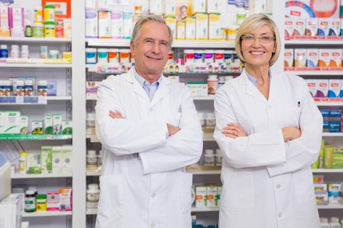 Male and female pharmacists.