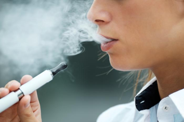 Woman using an e-cigarette.