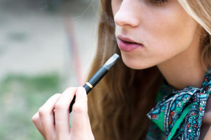 A girl using an e-cigarette.