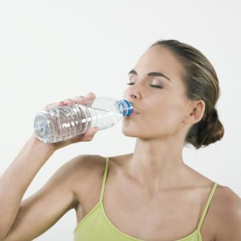 A woman drinking a bottle of water