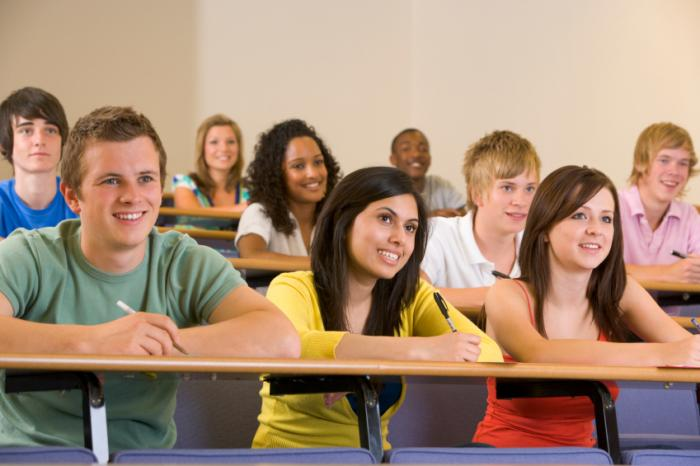 College students sitting in a lecture theater.
