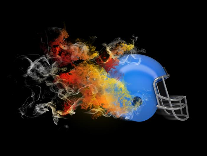An American football helmet with flames coming out of it.
