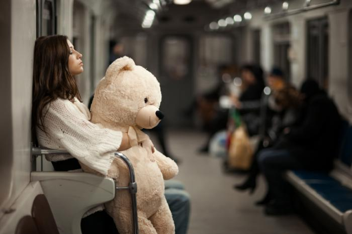 [woman with teddy bear]