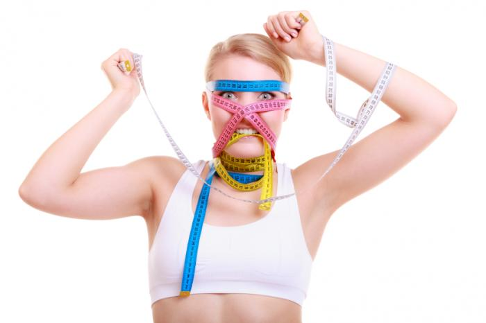Woman with tape measures on face