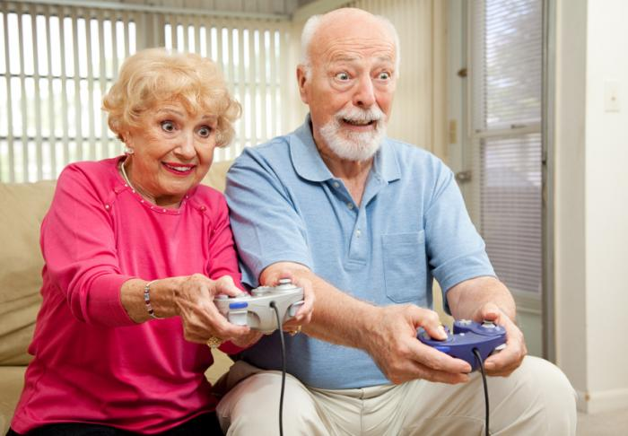 [An older couple playing a video game]