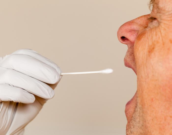Saliva swab being taken from a man
