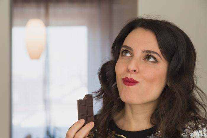 [A woman eating chocolate]