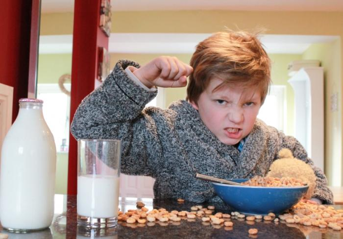 Child with ADHD eating breakfast