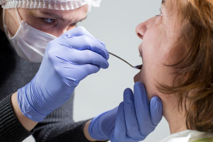 A dentist examining woman's teeth