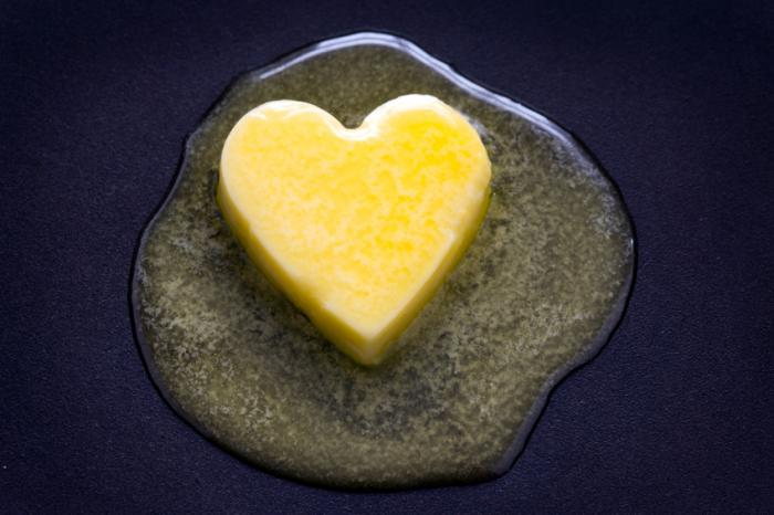 [Butter frying in the pan shaped like a heart]