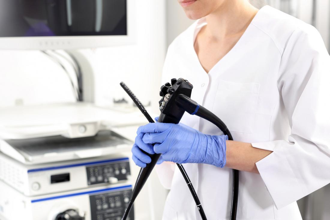 Gastrologist with endoscope