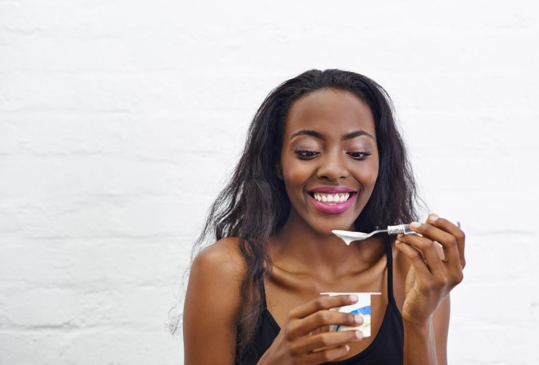 Women eats probiotic