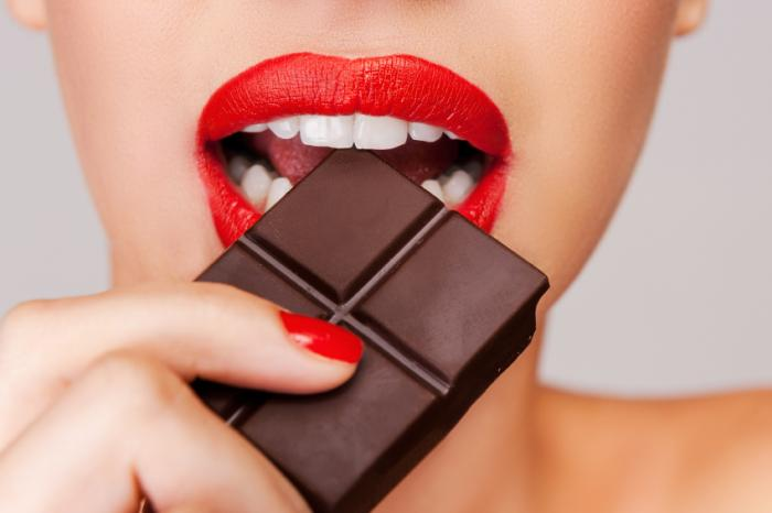 [A woman eating dark chocolate]