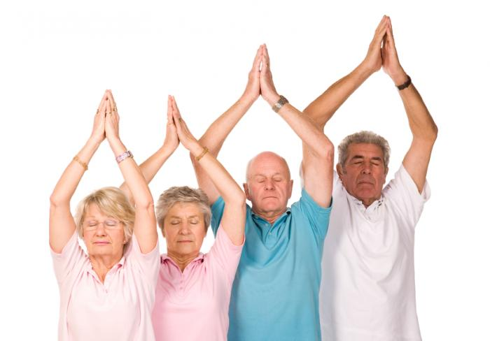 [Older adults practicing yoga]