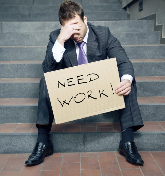 unemployed man with need work sign