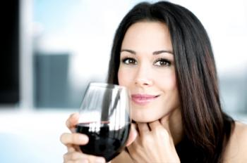 young woman with drink of red wine