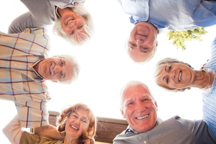 happy older people in a circle