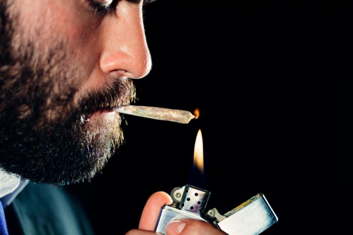 [A bearded man smoking marijuana]