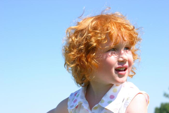 [Redheaded child in the sun]