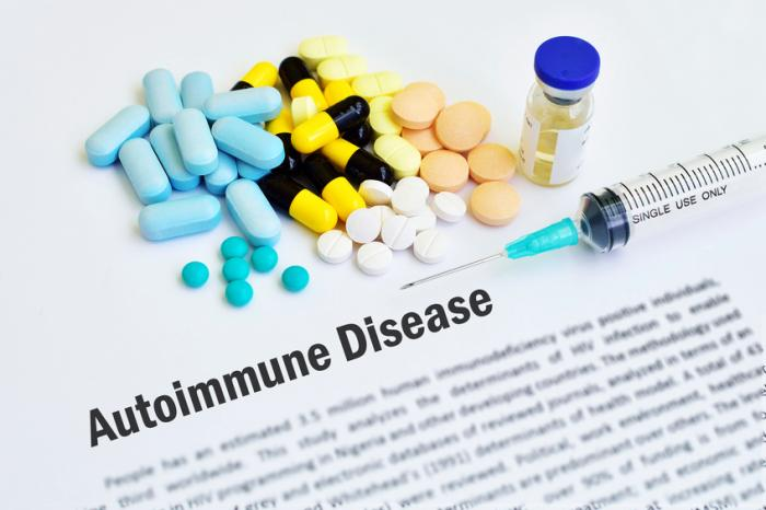 Autoimmune disease with pills and a syringe.